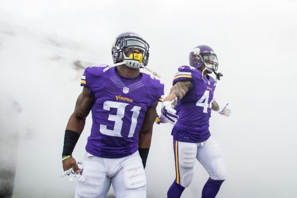 Dec 20, 2015; Minneapolis, MN, USA; Minnesota Vikings running back Jerick McKinnon (31) and running back Matt Asiata (44) run onto the field before the game against the Chicago Bears at TCF Bank Stadium. Mandatory Credit: Brad Rempel-USA TODAY Sports