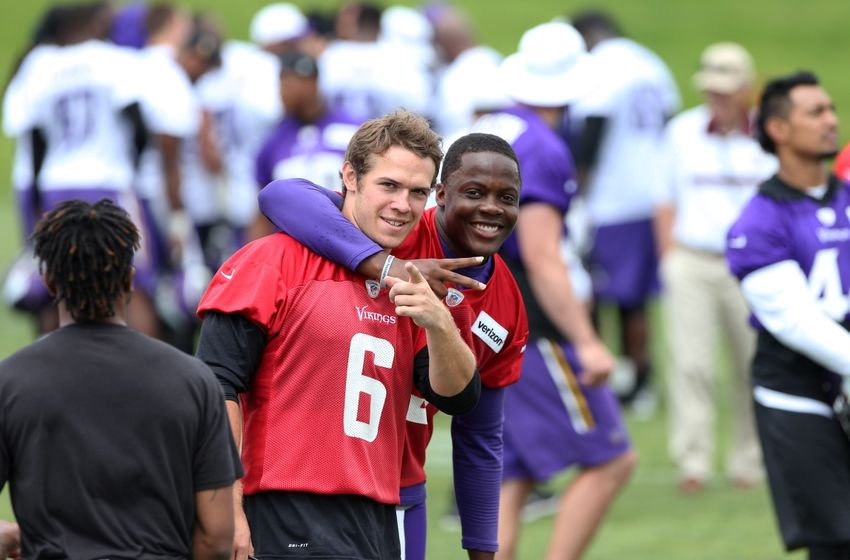 Jun 15, 2016; Minneapolis, MN, USA; Minnesota Vikings quarterback Teddy Bridgewater (5) and quarterback Taylor Heinicke (6) react after practice during mini camp. Mandatory Credit: Brad Rempel-USA TODAY Sports
