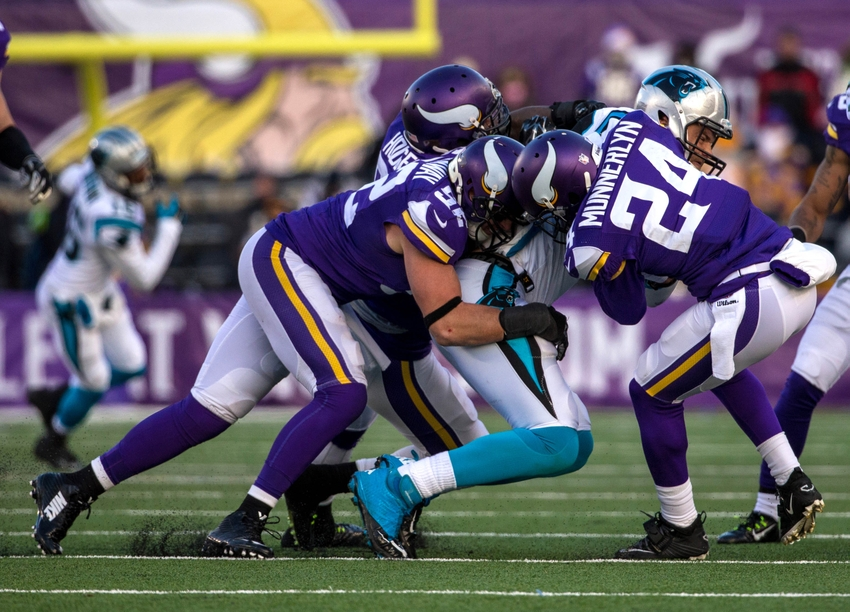 8241131-chad-greenway-greg-olsen-captain-munnerlyn-nfl-carolina-panthers-minnesota-vikings