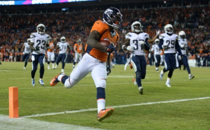 Jan 3, 2016; Denver, CO, USA; Denver Broncos running back Ronnie Hillman (23) scores a touchdown in the fourth quarter against the San Diego Chargers at Sports Authority Field at Mile High. The Broncos defeated the Chargers 27-20. Mandatory Credit: Ron Chenoy-USA TODAY Sports