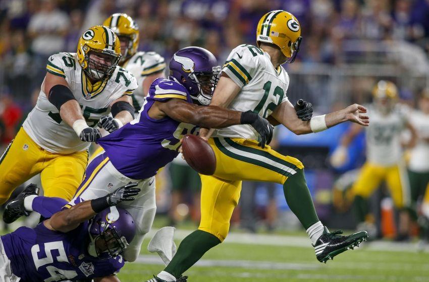 e7640d3a9 Sep 18, 2016; Minneapolis, MN, USA; Minnesota Vikings defensive end  Danielle Hunter (99) sacks Green Bay Packers quarterback Aaron Rodgers (12)  and forces a ...