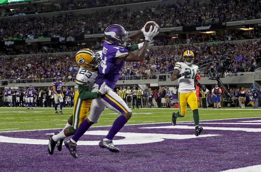 Sep 18, 2016; Minneapolis, MN, USA; Minnesota Vikings wide receiver Stefon Diggs (14) catches a touchdown pass past Green Bay Packers cornerback Damarious Randall (23) in the third quarter at U.S. Bank Stadium. The Vikings win 17-14. Mandatory Credit: Bruce Kluckhohn-USA TODAY Sports