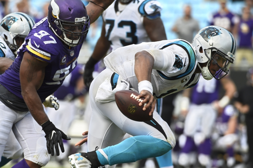 9567359-cam-newton-everson-griffen-nfl-minnesota-vikings-carolina-panthers