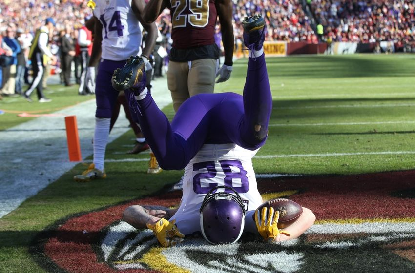 Nov 13, 2016; Landover, MD, USA; Minnesota Vikings tight end Kyle Rudolph (82) scores a touchdown against the Washington Redskins in the second quarter at FedEx Field. Mandatory Credit: Geoff Burke-USA TODAY Sports