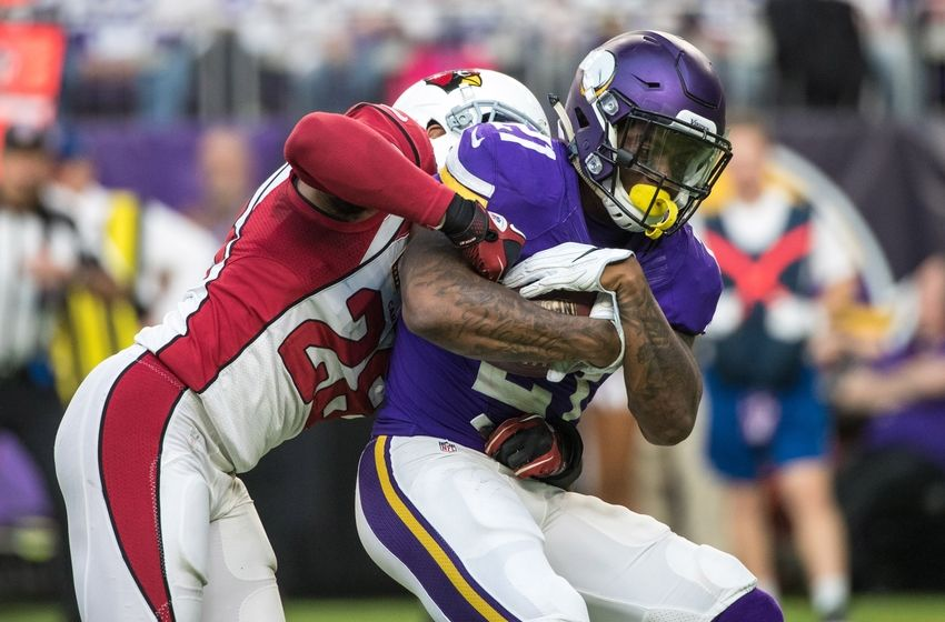 Nov 20, 2016; Minneapolis, MN, USA; Minnesota Vikings running back Jerick McKinnon (21) is tackled by Arizona Cardinals cornerback Justin Bethel (28) during the third quarter at U.S. Bank Stadium. The Vikings defeated the Cardinals 30-24. Mandatory Credit: Brace Hemmelgarn-USA TODAY Sports