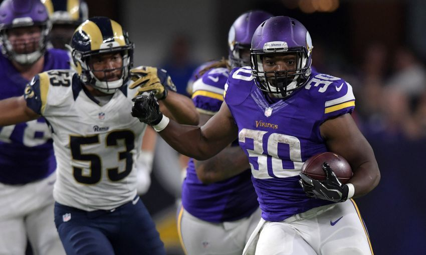 Sep 1, 2016; Minneapolis, MN, USA; Minnesota Vikings running back C.J. Ham (30) carries the ball against the Los Angeles Rams during a NFL game at U.S. Bank Stadium. Mandatory Credit: Kirby Lee-USA TODAY Sports
