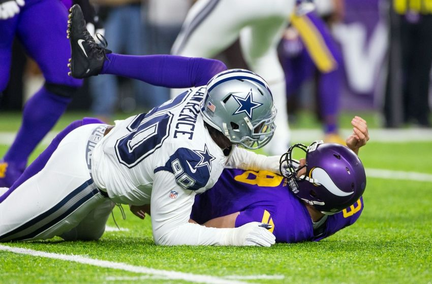 Dec 1, 2016; Minneapolis, MN, USA; Dallas Cowboys defensive lineman DeMarcus Lawrence (90) tackles Minnesota Vikings quarterback Sam Bradford (8) in the first quarter at U.S. Bank Stadium. Mandatory Credit: Brad Rempel-USA TODAY Sports