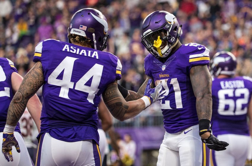 Jan 1, 2017; Minneapolis, MN, USA; Minnesota Vikings running back Jerick McKinnon (21) celebrates his touchdown with running back Matt Asiata (44) during the fourth quarter at U.S. Bank Stadium. Mandatory Credit: Brace Hemmelgarn-USA TODAY Sports