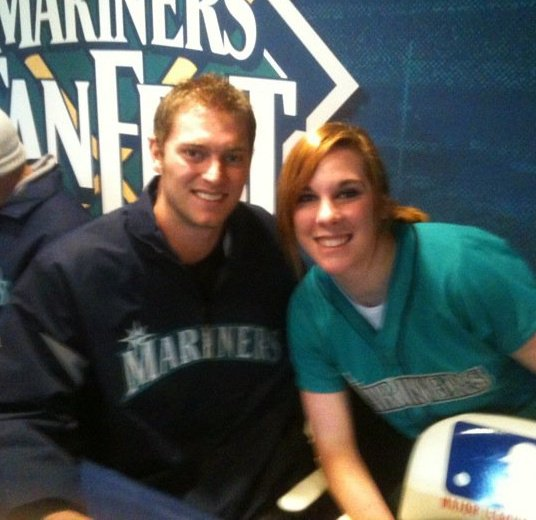 Mariners Fan Stephanie Powers poses for a picture with Michael Saunders at Fan Fest.