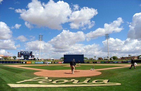Mar 19, 2012; Peoria, AZ, USA; Members of the Peoria Stadium grounds crew work to prep the field for the spring training game between the Chicago Cubs and Seattle Mariners. Mandatory Credit: Christopher Hanewinckel-USA TODAY Sports