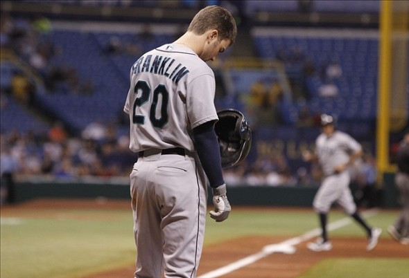 Aug 15, 2013; St. Petersburg, FL, USA; Seattle Mariners second baseman Nick Franklin (20) reacts after he stuck out and left the bases loaded during the fifth inning against the Tampa Bay Rays at Tropicana Field. Mandatory Credit: Kim Klement-USA TODAY Sports