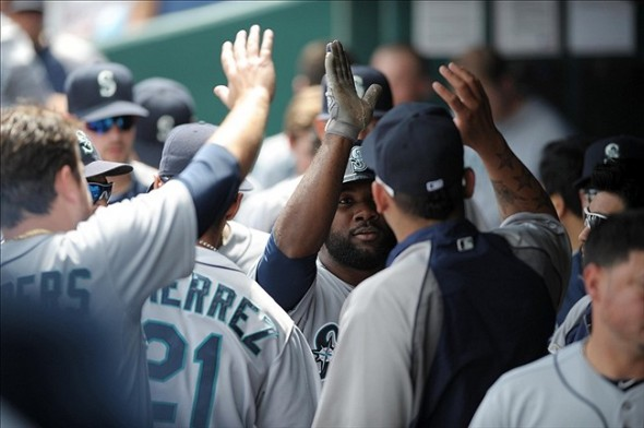 Sep 5, 2013; Kansas City, MO, USA; Seattle Mariners right fielder Abraham Almonte (36) is congratulated in the dugout after scoring in the first inning of the game against the Kansas City Royals at Kauffman Stadium. Mandatory Credit: Denny Medley-USA TODAY Sports