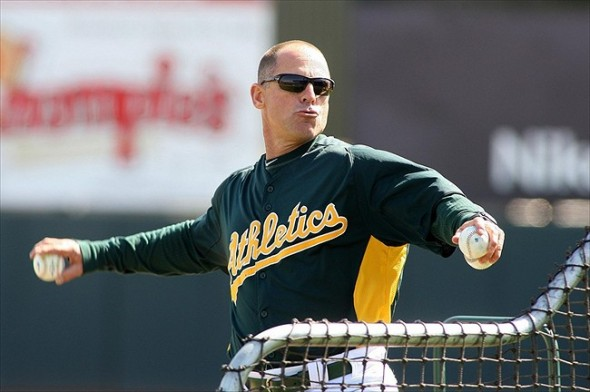 Mar 7, 2012; Phoenix, AZ, USA; Oakland Athletics bench coach Chip Hale (5) throws batting practice before a game against the Los Angeles Dodgers at Phoenix Municipal Stadium. Mandatory Credit: Jake Roth-USA TODAY Sports