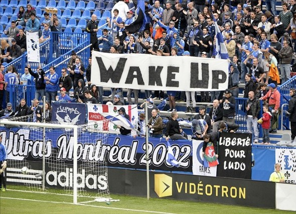 "Oct 19, 2013; Montreal, Quebec, CAN; Montreal Impact fans unfurl a banner that reads ""wake up"" before the match against the Philadelphia Union at Stade Saputo. Mandatory Credit: Eric Bolte-USA TODAY Sports"