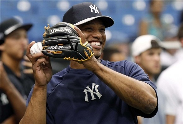 May 25, 2013; St. Petersburg, FL, USA; New York Yankees second baseman Robinson Cano (24) smiles prior to the game against the Tampa Bay Rays at Tropicana Field. Mandatory Credit: Kim Klement-USA TODAY Sports