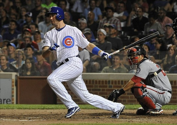 Aug 21, 2013; Chicago, IL, USA; Chicago Cubs pinch hitter Cole Gillespie (2) hits an RBI single against the Washington Nationals during the fifth inning at Wrigley Field. Mandatory Credit: David Banks-USA TODAY Sports