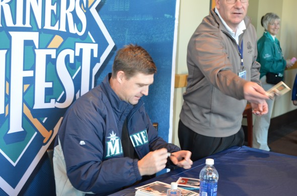 Signing fast and furious is Mariners Hall of Famer Dan Wilson. Class act as always. Credit: Dan Hughes