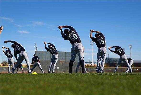 Feb 13, 2014; Peoria, AZ, USA; Seattle Mariners players stretch during team workouts at Peoria Sports Complex. Mandatory Credit: Mark J. Rebilas-USA TODAY Sports