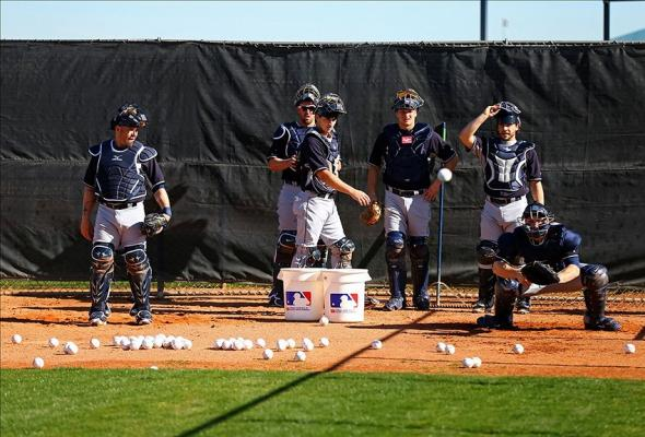 Feb 13, 2014; Peoria, AZ, USA; Seattle Mariners catchers do drills during team workouts at Peoria Sports Complex. Mandatory Credit: Mark J. Rebilas-USA TODAY Sports