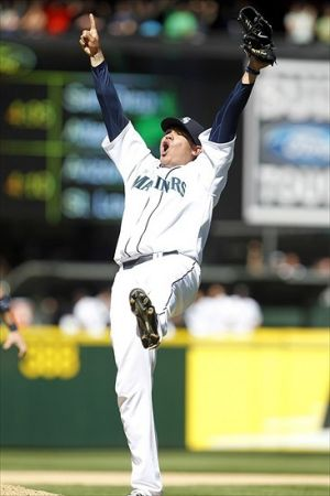 Aug 15, 2012; Seattle, WA, USA; Seattle Mariners pitcher Felix Hernandez (34) celebrates the final out of a perfect game against the Tampa Bay Rays at Safeco Field. Mandatory Credit: Joe Nicholson-USA TODAY Sports