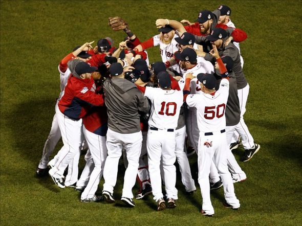 Oct 30, 2013; Boston, MA, USA; The Boston Red Sox react after defeating the St. Louis Cardinals in game six of the MLB baseball World Series at Fenway Park. Red Sox won 6-1. Mandatory Credit: Mark L. Baer-USA TODAY Sports