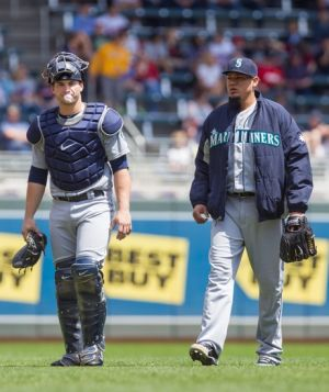 May 18, 2014; Minneapolis, MN, USA; Seattle Mariners catcher Mike Zunino (3) and starting pitcher Felix Hernandez (34) walk to the dugout at Target Field. Mandatory Credit: Brad Rempel-USA TODAY Sports