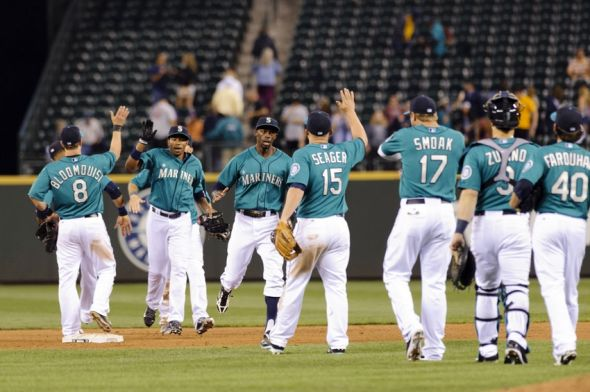 Jul 21, 2014; Seattle, WA, USA; The Seattle Mariners celebrate after defeating the New York Mets at Safeco Field. Seattle defeated New York 5-2. Mandatory Credit: Steven Bisig-USA TODAY Sports