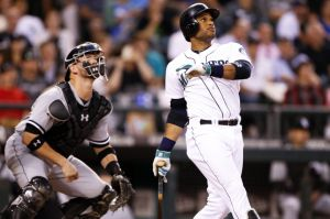 Aug 7, 2014; Seattle, WA, USA; Seattle Mariners second baseman Robinson Cano (22) hits a two-run home run against the Chicago White Sox during the fifth inning at Safeco Field. Mandatory Credit: Joe Nicholson-USA TODAY Sports