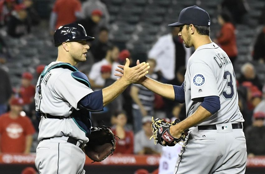 April 22, 2016; Anaheim, CA, USA; Seattle Mariners relief pitcher Steve Cishek (31) and catcher Chris Iannetta (33) celebrate the 5-2 victory against Los Angeles Angels at Angel Stadium of Anaheim. Mandatory Credit: Richard Mackson-USA TODAY Sports