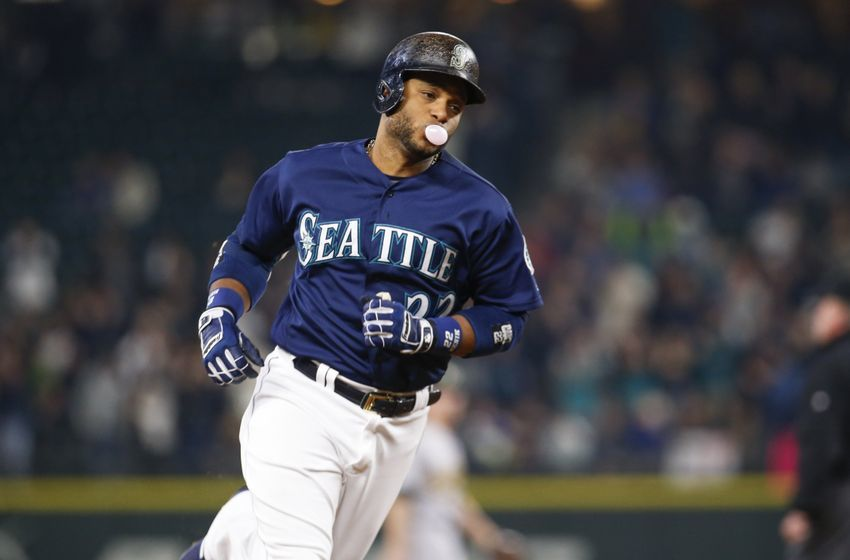 Sep 30, 2016; Seattle, WA, USA; Seattle Mariners second baseman Robinson Cano (22) runs the bases after hitting a two-run homer against the Oakland Athletics during the first inning at Safeco Field. Mandatory Credit: Joe Nicholson-USA TODAY Sports