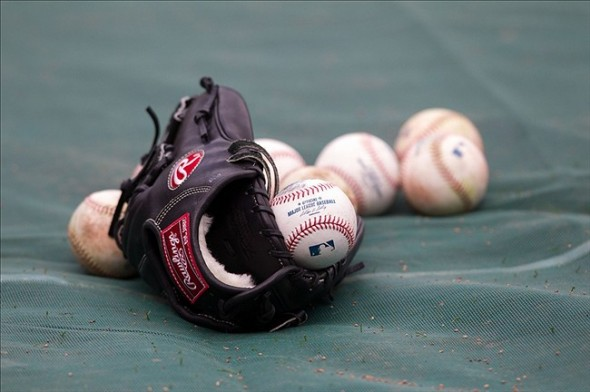 Apr 15, 2013; Minneapolis, MN, USA; Baseballs and a glove rest on the field prior to the game between the Minnesota Twins and Los Angeles Angels at Target Field. Mandatory Credit: Brace Hemmelgarn-USA TODAY Sports