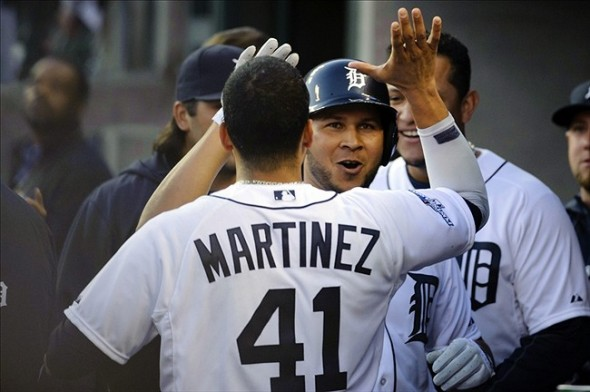 Oct 8, 2013; Detroit, MI, USA; Detroit Tigers outfielder Jhonny Peralta (right) celebrates with designated hitter Victor Martinez (41) after hitting a three-run home run against the Oakland Athletics during the fifth inning in game four of the American League divisional series at Comerica Park. Mandatory Credit: Tim Fuller-USA TODAY Sports