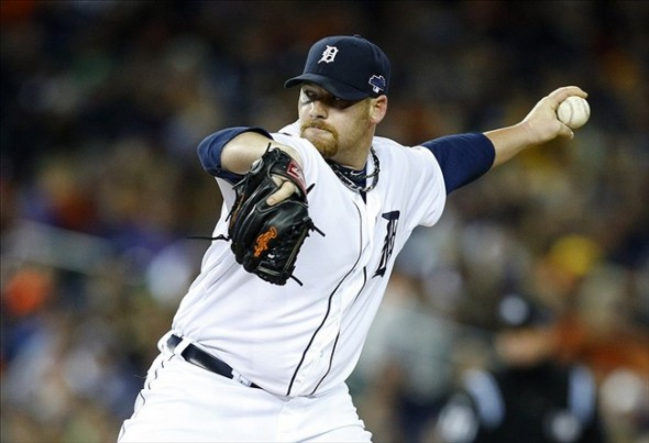 Oct 17, 2013; Detroit, MI, USA; Detroit Tigers relief pitcher Phil Coke (40) throws against the Boston Red Sox during the seventh inning in game five of the American League Championship Series baseball game at Comerica Park. Mandatory Credit: Rick Osentoski-USA TODAY Sports