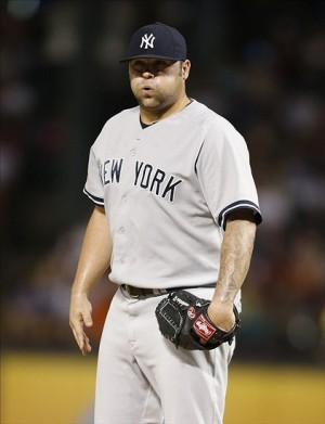 Jul 23, 2013; Arlington, TX, USA; New York Yankees relief pitcher Joba Chamberlain (62) on the mound during the eighth inning of the game against the Texas Rangers at Rangers Ballpark in Arlington. The Yankees won 5-4. Mandatory Credit: Tim Heitman-USA TODAY Sports