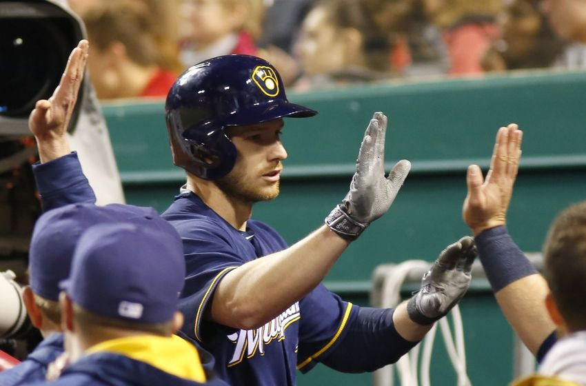 May 5, 2016; Cincinnati, OH, USA; Milwaukee Brewers right fielder Alex Presley is congratulated after hitting a two-run home run against the Cincinnati Reds during the eighth inning at Great American Ball Park. The Reds won 9-5. Mandatory Credit: David Kohl-USA TODAY Sports