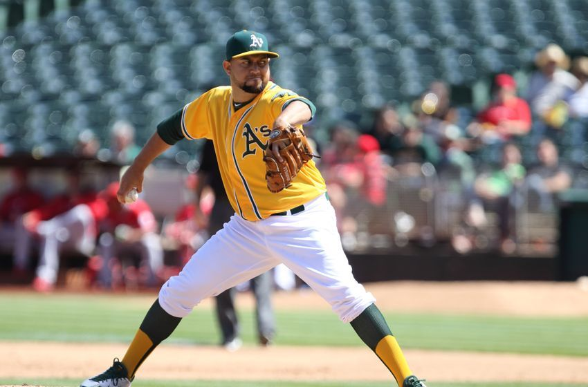 Sep 2, 2015; Oakland, CA, USA; Oakland Athletics relief pitcher Edward Mujica (49) pitches the ball against the Los Angeles Angels during the sixth inning at O.co Coliseum. Mandatory Credit: Kelley L Cox-USA TODAY Sports