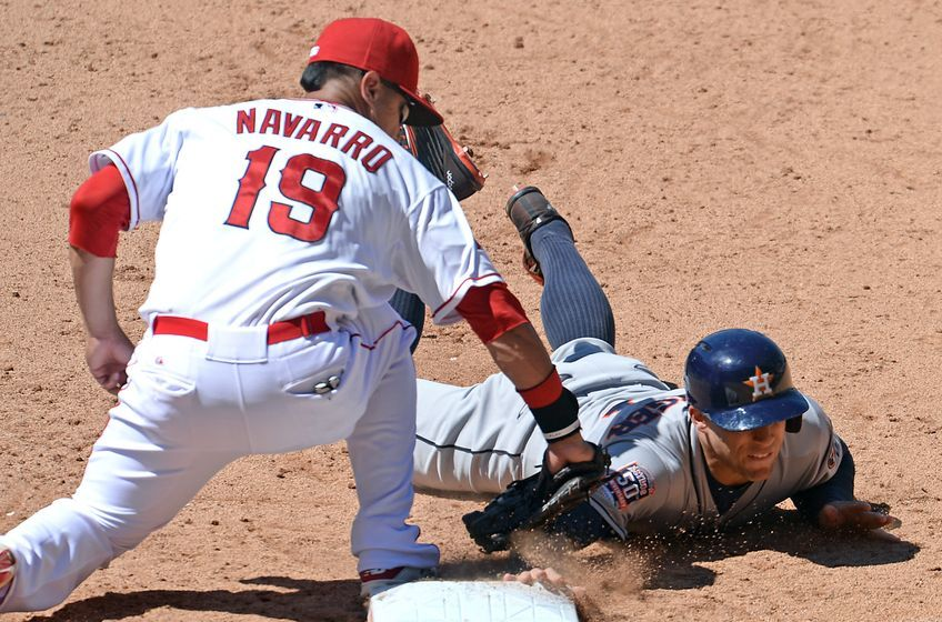 Jun 24, 2015; Anaheim, CA, USA; Los Angeles Angels left fielder Efren Navarro (19) makes the tag as Houston Astros right fielder George Springer (4) is picked off at first base in the eighth inning of the game at Angel Stadium of Anaheim. Angels won 2-1. Mandatory Credit: Jayne Kamin-Oncea-USA TODAY Sports