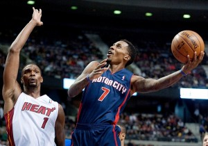 Dec 8, 2013; Auburn Hills, MI, USA; Detroit Pistons point guard Brandon Jennings (7) goes to the basket against Miami Heat center Chris Bosh (1) during the fourth quarter at The Palace of Auburn Hills. Miami won 110-95. Mandatory Credit: Tim Fuller-USA TODAY Sports