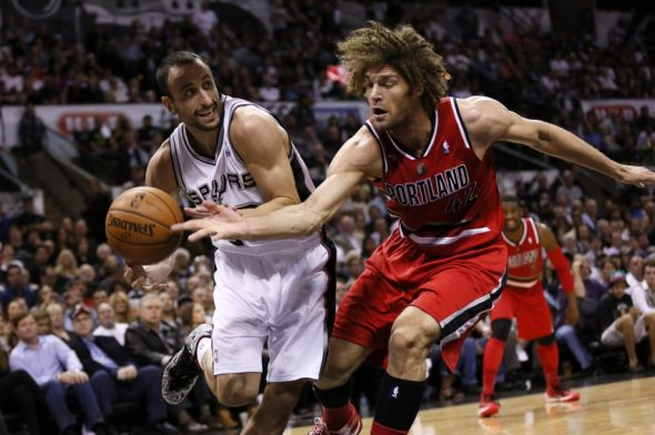 May 14, 2014; San Antonio, TX, USA; Portland Trail Blazers center Robin Lopez (42) attempts to knock the ball away from San Antonio Spurs guard Manu Ginobili (20) in game five of the second round of the 2014 NBA Playoffs at AT&T Center. Mandatory Credit: Soobum Im-USA TODAY Sports