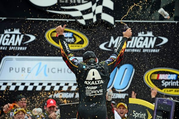 Aug 17, 2014; Brooklyn, MI, USA; NASCAR Sprint Cup Series driver Jeff Gordon celebrates in victory lane after winning the Pure Michigan 400 at Michigan International Speedway. Mandatory Credit: Andrew Weber-USA TODAY Sports