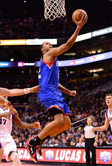 Jan. 2, 2013; Phoenix, AZ, USA: Philadelphia 76ers forward Evan Turner (12) lays in the ball in the first half against the Phoenix Suns at the US Airways Center. Mandatory Credit: Mark J. Rebilas-USA TODAY Sports