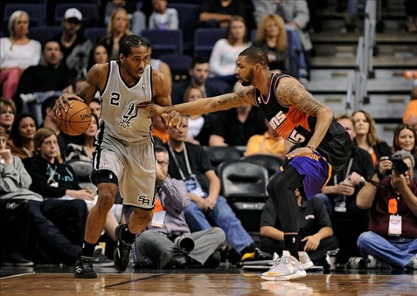 Feb. 24, 2013; Phoenix, AZ, USA; San Antonio Spurs forward Kawhi Leonard (2) handles the ball against the Phoenix Suns forward Marcus Morris (15) in the first half at US Airways Center. The Spurs defeated the Suns 97-87. Mandatory Credit: Jennifer Stewart-USA TODAY Sports
