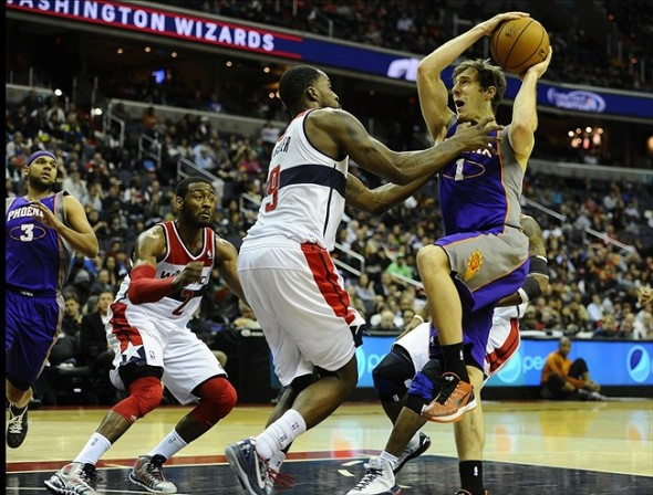 Mar 16, 2013; Washington, DC, USA; Phoenix Suns point guard Goran Dragic (1) drives to the basket as Washington Wizards small forward Martell Webster (9) and guard John Wall (2) defend during the second half at the Verizon Center. The Wizards defeated the Suns 127 - 105. Mandatory Credit: Brad Mills-USA Today Sports