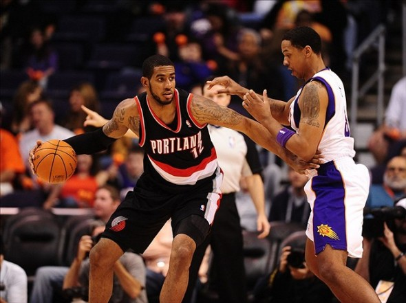 Jan. 6, 2012; Phoenix, AZ, USA; Portland Trail Blazers forward LaMarcus Aldridge controls the ball against Phoenix Suns center Channing Frye at the US Airways Center. The Suns defeated the Trail Blazers 102-77. Mandatory Credit: Mark J. Rebilas-USA TODAY Sports