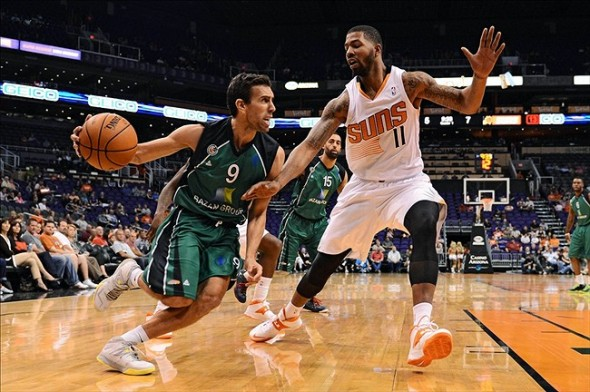 Oct 7, 2013; Phoenix, AZ, USA; Haifa guard Moran Roth (9) drives the ball against Phoenix Suns forward Markieff Morris (11) in the first half at US Airways Center. Mandatory Credit: Jennifer Stewart-USA TODAY Sports