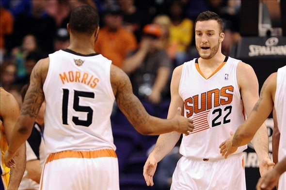 Dec 23, 2013; Phoenix, AZ, USA; Phoenix Suns forward Miles Plumlee (22) is congratulated by teammate forward Marcus Morris (15) in the first half against the Los Angeles Lakers at US Airways Center. The Suns won 117-90. Mandatory Credit: Jennifer Stewart-USA TODAY Sports