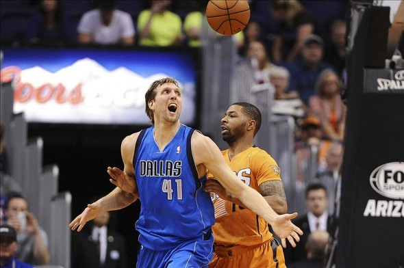 Jan 17, 2014; Phoenix, AZ, USA; Dallas Mavericks forward Dirk Nowitzki (41) watches the ball while being guarded by Phoenix Suns forward Marcus Morris (15) in the second half at US Airways Center. The Mavericks won 110-107. Mandatory Credit: Jennifer Stewart-USA TODAY Sports