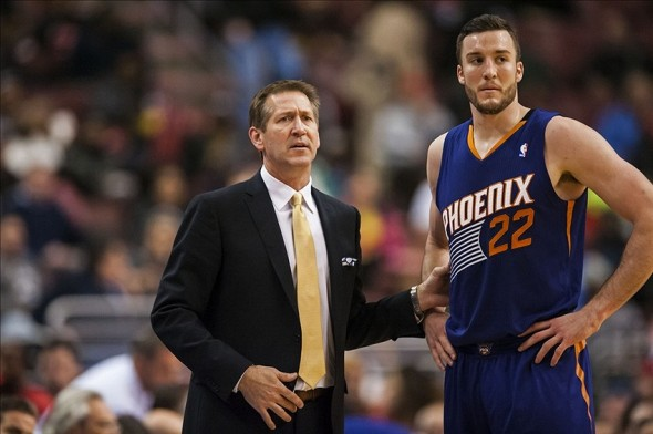 Jan 27, 2014; Philadelphia, PA, USA; Phoenix Suns head coach Jeff Hornacek talks with center Miles Plumlee (22) during the third quarter against the Philadelphia 76ers at the Wells Fargo Center. The Suns defeated the Sixers 124-113. Mandatory Credit: Howard Smith-USA TODAY Sports