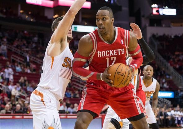 Feb 5, 2014; Houston, TX, USA; Phoenix Suns center Miles Plumlee (22) guards Houston Rockets center Dwight Howard (12) during the first quarter at the Toyota Center. Mandatory Credit: Jerome Miron-USA TODAY Sports