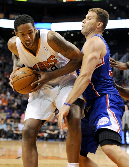Apr 2, 2014; Phoenix, AZ, USA; Phoenix Suns forward Channing Frye (8) is defended by Los Angeles Clippers forward Blake Griffin (32) during the third quarter at US Airways Center. The Clippers won 112-108. Mandatory Credit: Casey Sapio-USA TODAY Sports